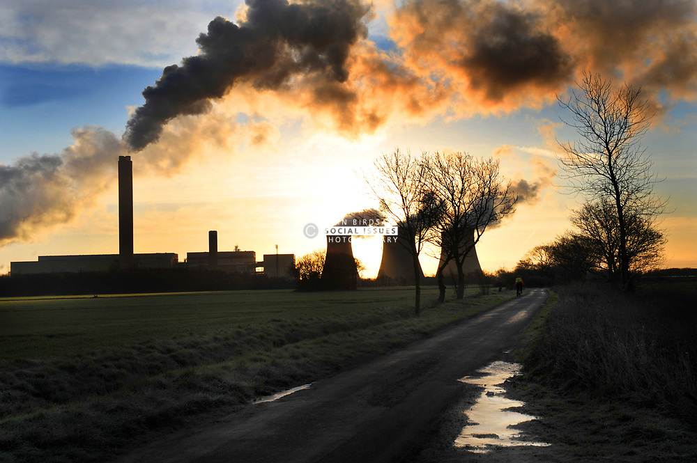 Drax Power Station, at sunrise Yorkshire UK. In February 2020 it was announced that Drax would stop burning coal by early 2021. March 2012