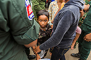 16 JUNE 2014 - POIPET, CAMBODIA: A child of Cambodian migrants in Poipet, Cambodia. More than 150,000 Cambodian migrant workers and their families have left Thailand since June 12. The exodus started when rumors circulated in the Cambodian migrant community that the Thai junta was going to crack down on undocumented workers. About 40,000 Cambodians were expected to return to Cambodia today. The mass exodus has stressed resources on both sides of the Thai/Cambodian border. The Cambodian town of Poipet has been over run with returning migrants. On the Thai side, in Aranyaprathet, the bus and train station has been flooded with Cambodians taking all of their possessions back to Cambodia.   PHOTO BY JACK KURTZ