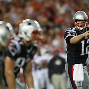 New England quarterback Tom Brady (12) calls out the play at the line of scrimmage during an NFL football game between the New England Patriots and the Tampa Bay Buccaneers at Raymond James Stadium on Thursday, August 18, 2011 in Tampa, Florida.   (Photo/Alex Menendez)