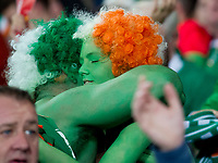 Football - 2017 / 2018 FIFA World Cup Qualifier - Group D: Wales vs. Republic of Ireland<br /> <br /> Irish fans painted green  embrace to celebrate victory at Cardiff City Stadium.<br /> <br /> COLORSPORT/WINSTON BYNORTH