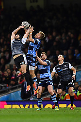 27th April 2019 , Principality Stadium , Cardiff, Wales ; Guinness pro 14's, Round 21, Cardiff Blues Vs Ospreys ; Dan Evans of Ospreys and Gareth Anscombe of Cardiff Blues contest the high ball<br /> <br /> Credit :  Craig Thomas/Replay Images