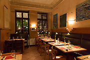 Interior tables and chairs of Miera bistro style restaurant in Huxstrasse, one of the most famous restaurants in Germany
