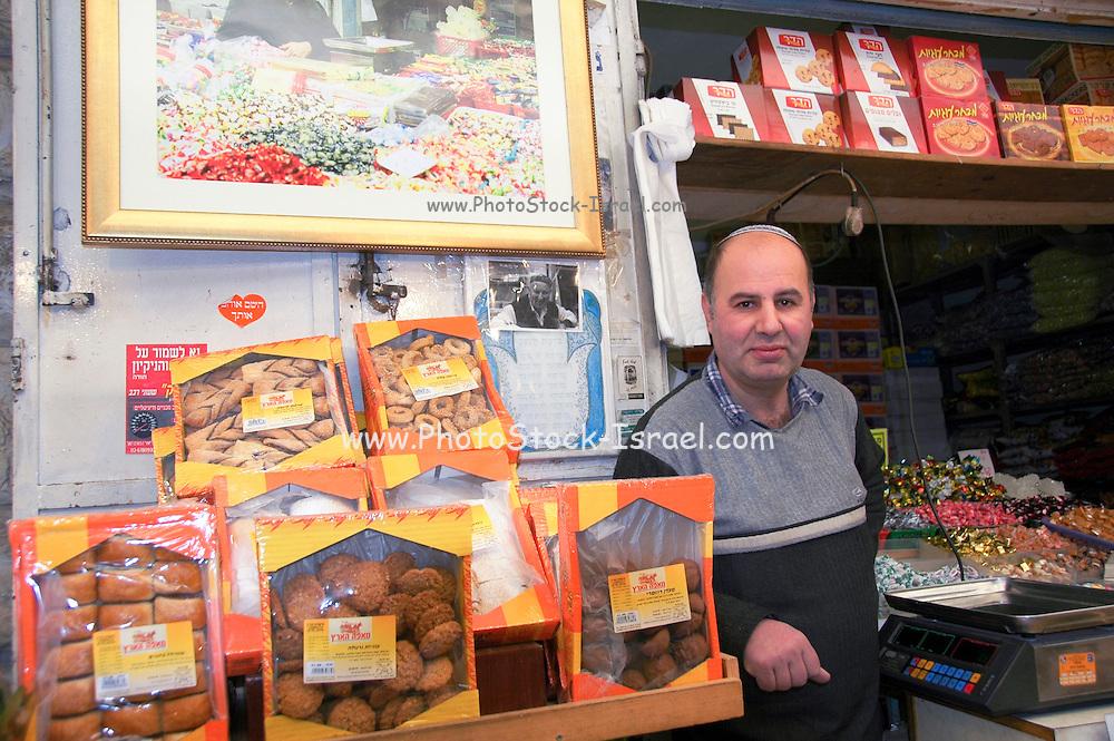 Israel, Jerusalem, Machane Yehuda market Seller at his stall