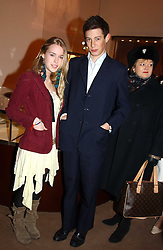 MARY CHARTERIS and JAMES ROTHSCHILD at a party to celebrate the 2nd anniversary of Quintessentially magazine held at Asprey, Bond Street, London on 24th February 2005.<br />