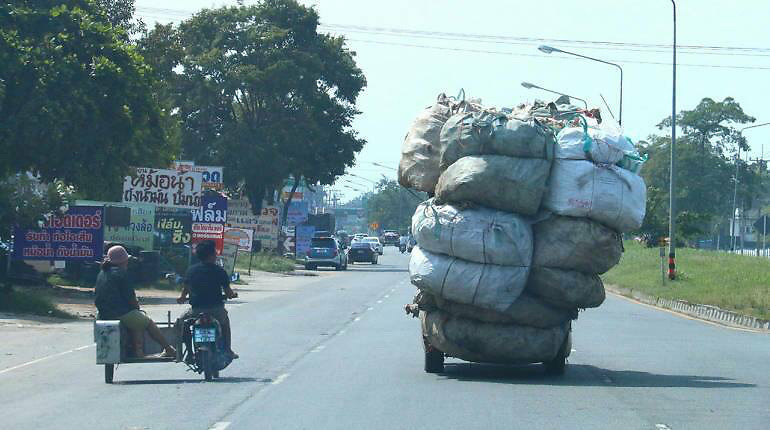 TRUCK OVERLOADED WITH 20 BAGS OF RUBBISH ALMOST SNAPS IN HALF<br /> <br /> This truck almost snapped in half after dangerously piling on more than TWENTY giant bags of rubbish.<br /> <br /> The driver was spotted with the heavy load piled 12ft high on the back of the wagon as he drove to a recycling plant in Chonburi near Pattaya, Thailand. <br /> <br /> Fellow motorists accused the man of putting other road users at risk - and trying to same fuel money by piling on the bags of waste metal and plastic.<br /> <br /> Shocking pictures show how the vehicle is travelling along a busy road while bent in the middle almost to breaking point.<br /> <br /> Stunned passerby Apiroom Sukjai said: ''There's no reason for doing something so dangerous. Roads are already so risky. He should be more sensible.<br /> <br /> ''People think the driver was trying to save money by putting all the bags on so he did not need to make two trips. What if one fell onto another car?''<br /> ©Exclusivepix Media