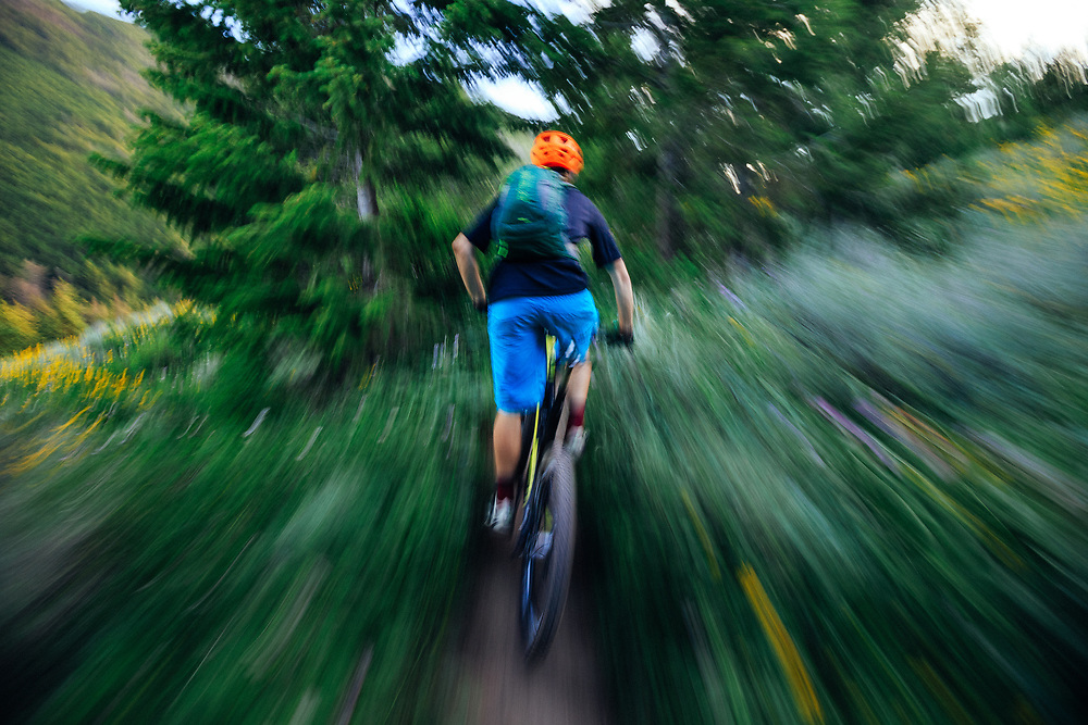 Andrew Whiteford rides through the wildflowers on the Putt Putt trail near downtown Jackson, Wyoming.