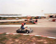 Pilot of the 'Red Arrows', Britain's Royal Air Force aerobatic team enjoys afternoon off from training on karting track.