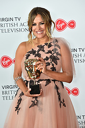 Caroline Flack holds the BAFTA award for Reality and Constructed Factual for Love Island at the Virgin TV British Academy Television Awards 2018 held at the Royal Festival Hall, Southbank Centre, London.