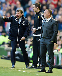 Rangers Manager Graeme Murty (left) shouts instructions to his players as Celtic manager Brendan Rodgers looks on during the Ladbrokes Scottish Premiership match at Celtic Park, Glasgow.