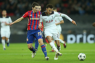 Dele Alli of Tottenham Hotspur competes for the ball with Astemir Gordyushenko of CSKA Moscow. UEFA Champions league match, group E, Tottenham Hotspur v CSKA Moscow at Wembley Stadium in London on Wednesday 7th December 2016.<br /> pic by John Patrick Fletcher, Andrew Orchard sports photography.