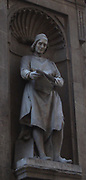 Statue located outside of the Uffizi museum in Florence, Italy. One of the oldest art museums in the Western World. Semi enclosed figurative statues such as this appear all over Florence. Bernardo Cennini, Italian goldsmith, sculptor and early printer of Florence.