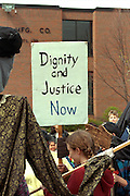 Activist dignity and justice placard at Cinco de Mayo festival.  St Paul Minnesota USA