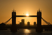 Sunrise behind Tower Bridge on the River Thames in London, England on February 12, 2018 following a very cold night in the capital with temperatures dropping to below zero degrees in some area of the city.