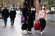 Two women are seen wearing masks in the CBD during COVID-19. After seeing another 177 cases overnight and further outbreaks in nursing homes, Metropolitan Melbourne and the Mitchell Shire are in lockdown following the rise of active cases to 1,612. The new restrictions came into effect on Thursday 9 July with residents in lockdown areas under stay at home orders for the next six weeks. (Photo be Dave Hewison/ Speed Media)