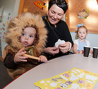 """The """"Cowardly Lion"""" Nicholas Ide and his sister """"Dorothy"""" Braelyn Ide make Ghost pops with help from mom (Kim Ide) during Gilford Library's annual Halloween Parade and Party on Wednesday morning.   (Karen Bobotas/for the Laconia Daily Sun)"""