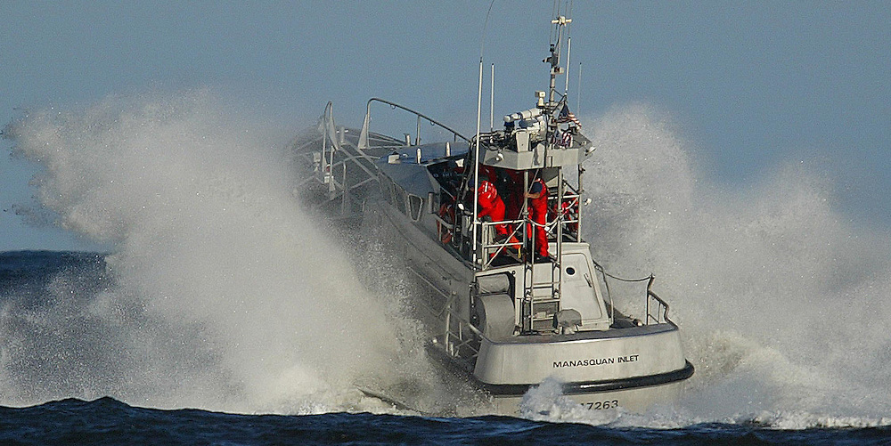 (POCEAN) Pt Pleasant. 9/9/2003  A U.S. Coast Guard boat works in the Manasquan Inlet as large swells and winds from tropical weather approaches the area.  Michael J. Treola Staff Photographer....MJT