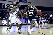 HIGH POINT, NC - JANUARY 06: Charleston Southern's Phlandrous Fleming, Jr. (24) and High Point's Andre Fox (22). The High Point University of Panthers hosted the Charleston Southern University Buccaneers on January 6, 2018 at Millis Athletic Convocation Center in High Point, NC in a Division I men's college basketball game. HPU won the game 80-59.