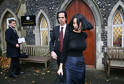 © Licensed to London News Pictures. 10/11/2015. Brighton, UK.  Nick Cave and Susie Bick leaving Brighton Coroner's Court. 15 year old Arthur Cave, the son of musician Nick Cave, died as the result of a fall from cliffs in Brighton in July 2015. Photo credit: Peter Macdiarmid/LNP