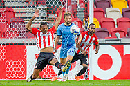 Brentford defender Ethan Pinnock (5) clears the ball, Coventry City forward Matthew Godden (24) and Brentford defender Rico Henry (3) during the EFL Sky Bet Championship match between Brentford and Coventry City at Brentford Community Stadium, Brentford, England on 17 October 2020.