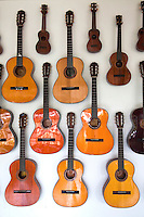 """Though pre-colonial Visayans had a variety of string instruments which used a coconut shell or gourd as resonator - the guitar is a Spanish introduction. Guitars have been made in Cebu since the Spanish period mainly as a areplacement for organs for church music until they were later imported. Yet, guitars  developed as a local industry only in the present century, receiving a boost from the government's promotion of cottage industries in the immediate postwar period. In Mactan, the craft of guitar making passes from generation to generation and the industry involves many families, the most prominent of whom is the Alegre and Malingin families whose names have become well-known """"brand names"""" of Mactan or Cebu guitars."""