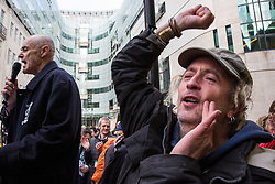 London, UK. 21st December, 2018. Donnachadh McCarthy (l), author, cycling campaigner and green lifestyle coach, addresses environmental campaigners from Extinction Rebellion protesting outside Broadcasting House against the lack of coverage by the BBC of the climate change crisis.