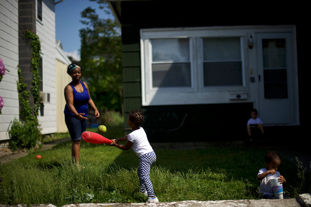 WILKES-BARRE- May 27, 2016.  Tenajah Mack, 3, plays baseball with her mother, Jasmine, in Wilkes-Barre, PA, a city of 41,000 in central Pennsylvania.  Wilkes-Barre is the county seat of Luzerne County, in which 77.4% of Republicans voted for Donald Trump.