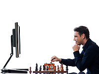 caucasian man playing chess triumphant against computer  concept on isolated white background