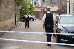 © Licensed to London News Pictures. 27/04/2020. London, UK. Police officers guard a crime scene outside an address on Aldborough Road North in Ilford where two children were stabbed to death and a 40 year old man suffered knife injuries last night . Photo credit: George Cracknell Wright/LNP
