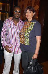 MR & MRS ORLANDO HAMILTON at a party to celebrate the publication of Air Babylon by Imogen Edwards-Jones held at Fifty, 50 St.James's Street, London SW1 on 4th July 2005.<br /><br />NON EXCLUSIVE - WORLD RIGHTS
