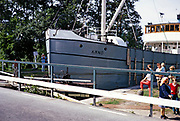 Cargo ship Arno passing through lock gates on inland waterway, Sweden 1970