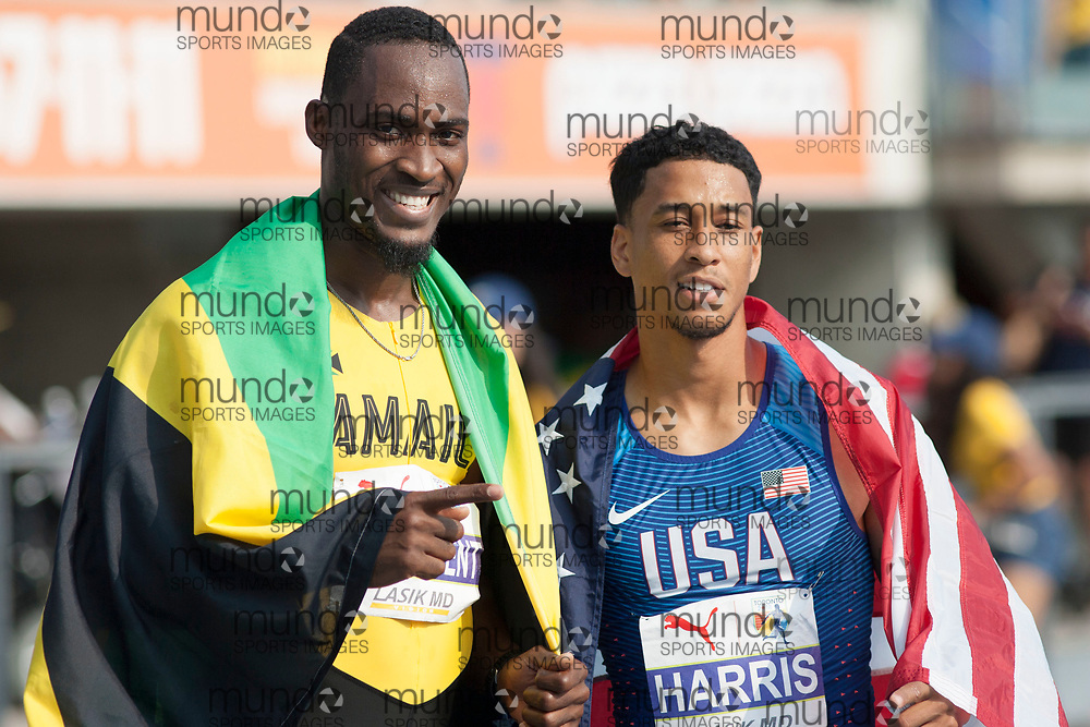 Toronto, ON -- 11 August 2018: Gold medalist Hansle Parchment (Jamaica) and silver medalist Aleec Harris (USA), 110m hurdles at the 2018 North America, Central America, and Caribbean Athletics Association (NACAC) Track and Field Championships held at Varsity Stadium, Toronto, Canada. (Photo by Sean Burges / Mundo Sport Images).