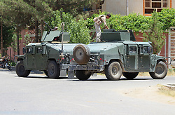 June 22, 2017 - Afghan security force members stands on military vehicles at the site of an attack in Helmand province, Afghanistan. At least 26 Afghans were killed and 59 others wounded when an explosion rocked a local bank office in Lashkar Gah city, capital of southern province of Helmand on Thursday, a local source said. (Credit Image: © Abduz Aziz Safdari/Xinhua via ZUMA Wire)