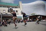 Cast of the hit musical STOMP perform in St Martins Square in Birmingham, United Kingdom.