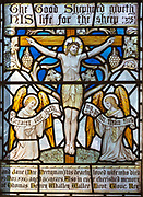 Victorian 19th century stained glass window Jesus Christ crucifixion with angels, Waldringfield church, Suffolk, England, UK