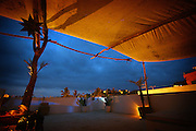 """SHOT 2/11/09 7:30:16 PM - Dusk settles in on the upper balcony of the Petit Hotel Hafa in Sayulita, Mexico. Located on Calle Jose-Mariscal in Sayulita Mexico, Petit Hotel d'Hafa is a quaint boutique hotel just steps away from the Sayulita plaza and less than a two minute stroll to the beach and surfing break. Sayulita is a small fishing village about 25 miles north of downtown Puerto Vallarta in the state of Nayarit, Mexico. Known for its consistent river mouth surf break, roving surfers """"discovered"""" Sayulita in the late 60's with the construction of Mexican Highway 200. Today, Sayulita is a prosperous growing village of approximately 4,000 residents. Hailed as a popular off-the-beaten-path travel destination, Sayulita offers a variety of activities such as horseback riding, hiking, jungle canopy tours, snorkeling and fishing. Still a mecca for beginner surfers of all ages, the quaint town attracts upscale tourists with its numerous art galleries and restaurants as well. Sayulita has a curious eclectic quality, frequented by native Cora and Huichol peoples, travelling craftsmen as well as international tourists. Sayulita is the crown jewel in the newly designated """"Riviera Nayarit"""", the coastal corridor from Litibu to San Blas. It's stunning natural beauty and easy access to Puerto Vallarta have made Sayulita real estate some of the most sought after in all of Mexico..(Photo by Marc Piscotty / © 2009)"""