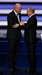 Russian president Vladimir Putin (right) shakes the hand of FIFA President Gianni Infantino during the FIFA 2018 World Cup draw at The Kremlin, Moscow. PRESS ASSOCIATION Photo Picture date: Friday December 1, 2017. See PA story SOCCER World Cup. Photo credit should read: Nick Potts/PA Wire. RESTICTIONS: Editorial use only. No transmission of sound or moving images. No use with any unofficial third party logos. No altering or adjusting of photographs.