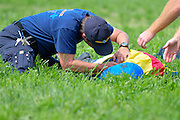 20 March 2010 : Paramedics attend to Roddy Mackenzie who took a fall at the first fence aboard Tom's Last Chance. Mackenzie broke his clavicle and sustained a severe concussion in the accident. He was taken to the hospital immediately following the fall.