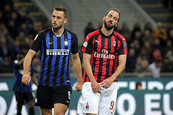 October 21, 2018 - Milan, Milan, Italy - Gonzalo Higuain #9 of AC Milan reacts to a missed chance during the serie A match between FC Internazionale and AC Milan at Stadio Giuseppe Meazza on October 21, 2018 in Milan, Italy. (Credit Image: © Giuseppe Cottini/NurPhoto via ZUMA Press)