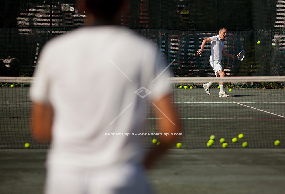 Gerald Marzorati takes tennis lessons from coach Kirill Azovtsev at the NTAC Tennis facility in Pelham, NY... Photo by Robert Caplin