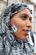 Protest against Israel's latest attack on Gaza, July 19th 2014 , Operation Protective edge. A young woman wearing a headscarf has a Palestinian sticker on her face.
