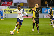 Tottenham Hotspur midfielder Gedson Fernandes (30) runs with the ball ahead of Marine midfieler Josh Hmami (8) during the The FA Cup match between Marine and Tottenham Hotspur at Marine Travel Arena, Great Crosby, United Kingdom on 10 January 2021.