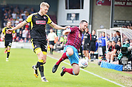 Scunthorpe United's Rory McArdle (23) and Rotherham United forward Michael Smith (24) during the EFL Sky Bet League 1 match between Scunthorpe United and Rotherham United at Glanford Park, Scunthorpe, England on 12 May 2018. Picture by Nigel Cole.