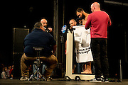 Johny Hendricks goes down to the towel during his first weigh-in attempt for UFC 171 in Dallas, Texas on March 14, 2014. Johny came in 1.5 lbs over and had two hours to shed the remaining weight.