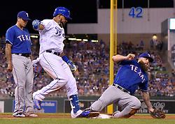 July 14, 2017 - Kansas City, MO, USA - Texas Rangers first baseman Mike Napoli reaches first ahead of Kansas City Royals' Jorge Bonifacio on a groundout in the eighth inning July 14, 2017 at Kauffman Stadium in Kansas City, Mo. The Rangers won, 5-3. (Credit Image: © John Sleezer/TNS via ZUMA Wire)