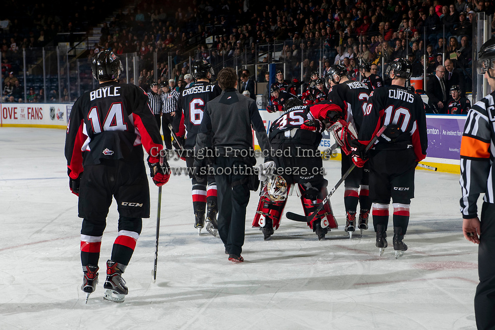 KELOWNA, CANADA - FEBRUARY 8:  Taylor Gauthier #35 of the Prince George Cougars is escorted off the ice after a third period injury against the Kelowna Rockets on February 8, 2019 at Prospera Place in Kelowna, British Columbia, Canada.  (Photo by Marissa Baecker/Shoot the Breeze)