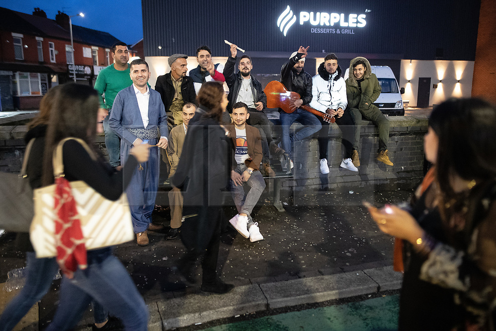 © Licensed to London News Pictures. 04/06/2019. Manchester, UK. The Kurdish crew and a Spanish guitarist on Wilmslow Road . People celebrate Eid-ul-Fitr , the end of a month of fasting during Ramadan , in Rusholme in Manchester . Photo credit: Joel Goodman/LNP