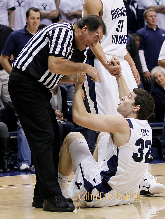 Official Randy McCall, left, and BYU guard Jimmer Fredette, right, react after a foul call during the first half of an NCAA basketball game, Nov. 17, 2010 in Provo, Utah. (AP Photo/Colin E Braley)