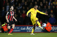 Liverpool striker Raheem Sterling shoots during the Capital One Cup match between Bournemouth and Liverpool at the Goldsands Stadium, Bournemouth, England on 17 December 2014.