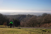Cyclist on top of the Clent Hills in Stourbridge on 19th January 2020 in Stourbridge, England, United Kingdom. The Clent Hills lie 10 miles south-west of Birmingham in Clent, Worcestershire. The closest towns are Stourbridge and Halesowen, both within the West Midlands conurbation.