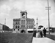 0405-D05 Grand Theatre & IOOF Lodge in Salem, Oregon. High Street & Court Street, Opera House Pharmacy. ca. 1913.